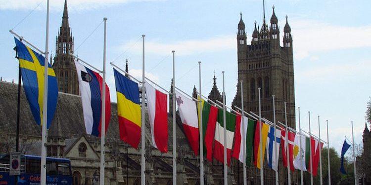 EU flags outside UK Houses of Parliament.