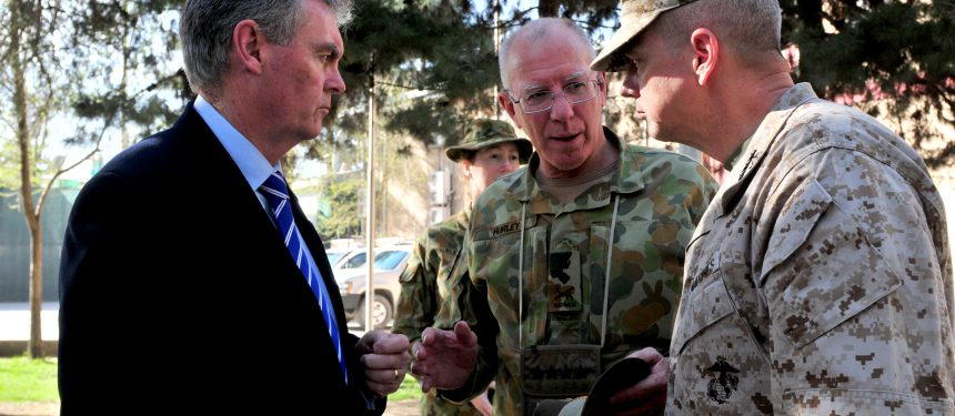 Prior to his current security role, Duncan Lewis (left) served as Australian Defence Secretary from 2011-12.